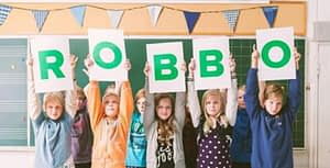 children holding ROBBO sign