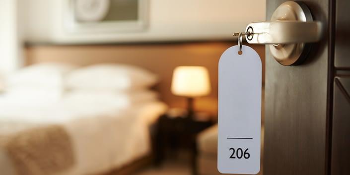 hotel open door key in lock