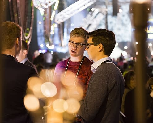 People having a chat at a Slush event in Helsinki