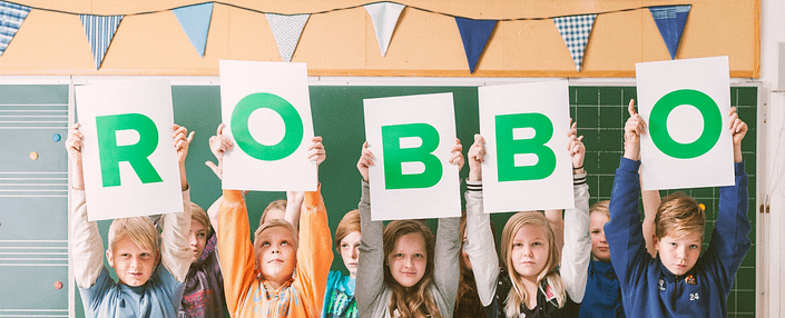 children holding a robbo sign