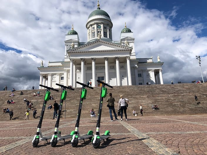 Lime e-scooters in front of Helsinki cathedral