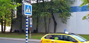 smart pedestrian crosswalk and a taxi