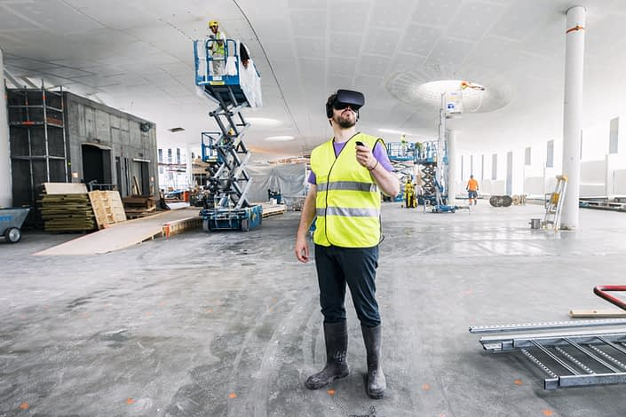 Smart city example: man trying VR at Oodi Library construction site